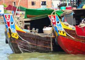Vietnam delta Mékong fleuve eaux bateaux VenSông Lodge guesthouse Un delta parcouru de milliers de bateaux colorés