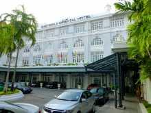 Asie Malaisie Penang Georgetown Eastern & Oriental Hotel palace hôtellerie L'une des entrées du palace de Georgetown dans l'île de Penang en Malaisie